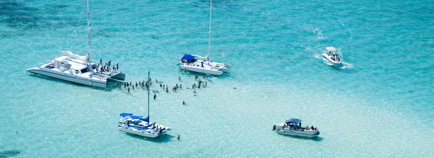 Aerial shot of boats anchored in Stingray City in the Cayman Islands