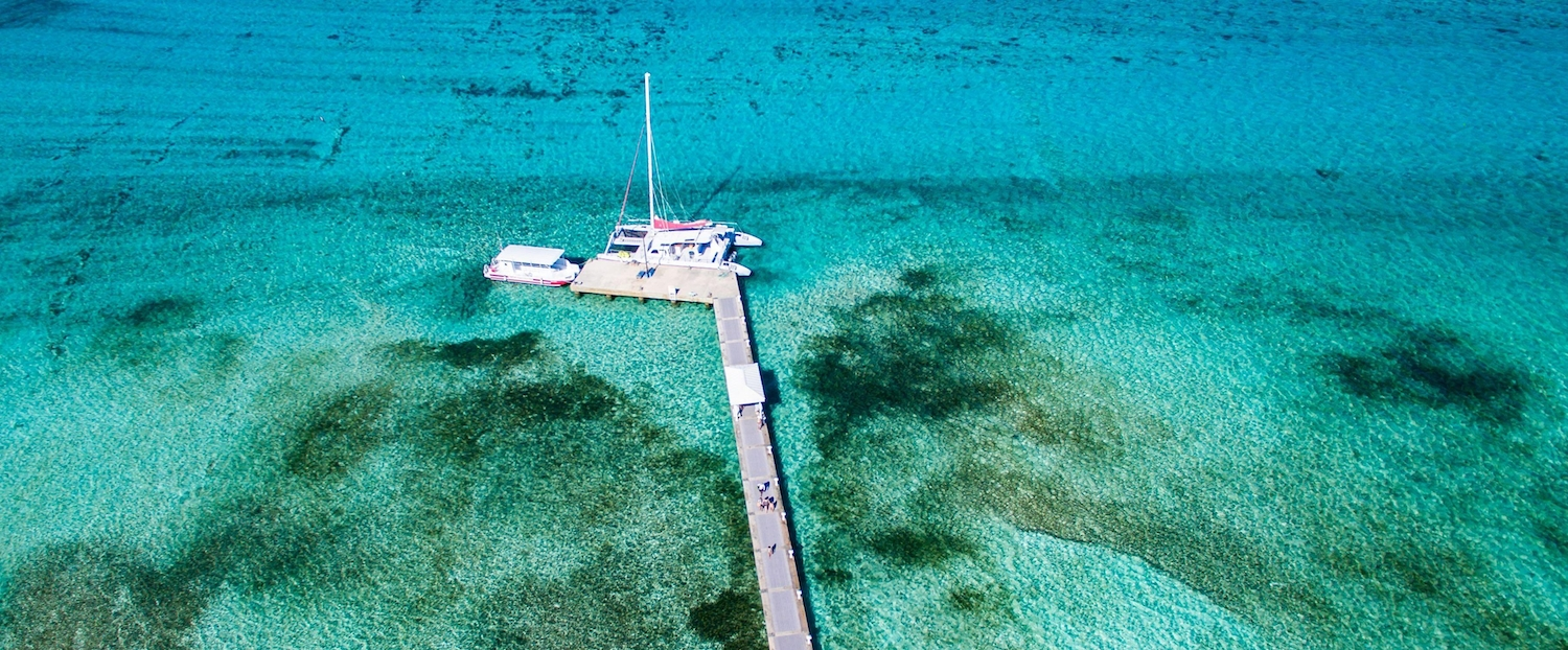 Aerial view of boat docked at a pier in the Cayman Islands