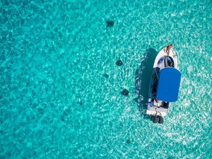 Aerial view of boat over Sting Ray City in the Cayman Islands