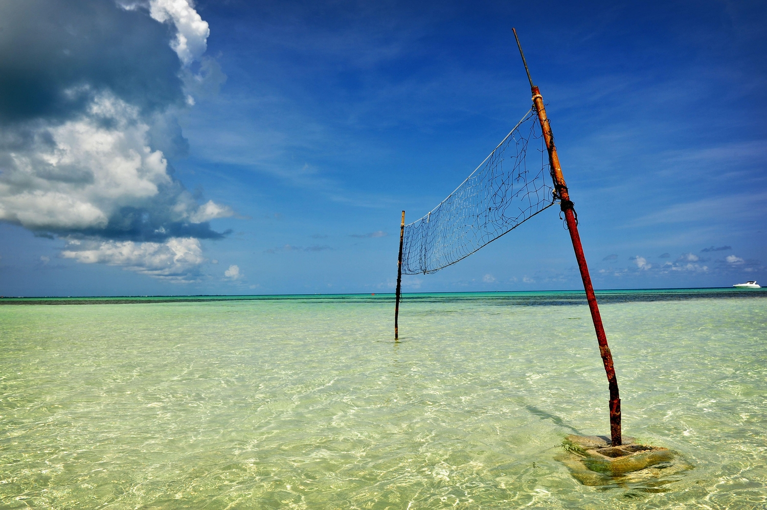 Beach volleyball net placed in the ocean