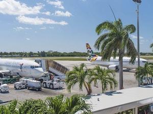 Cayman Airways airplanes parked at Owen Roberts International Airport