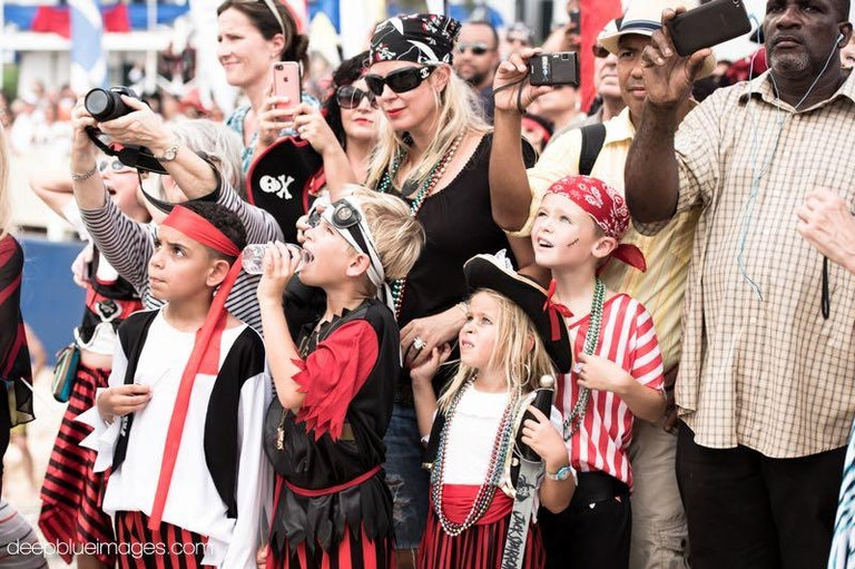 Children and adults dressed up for pirates week