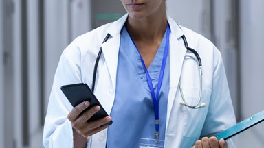Doctor consulting with patient for video call