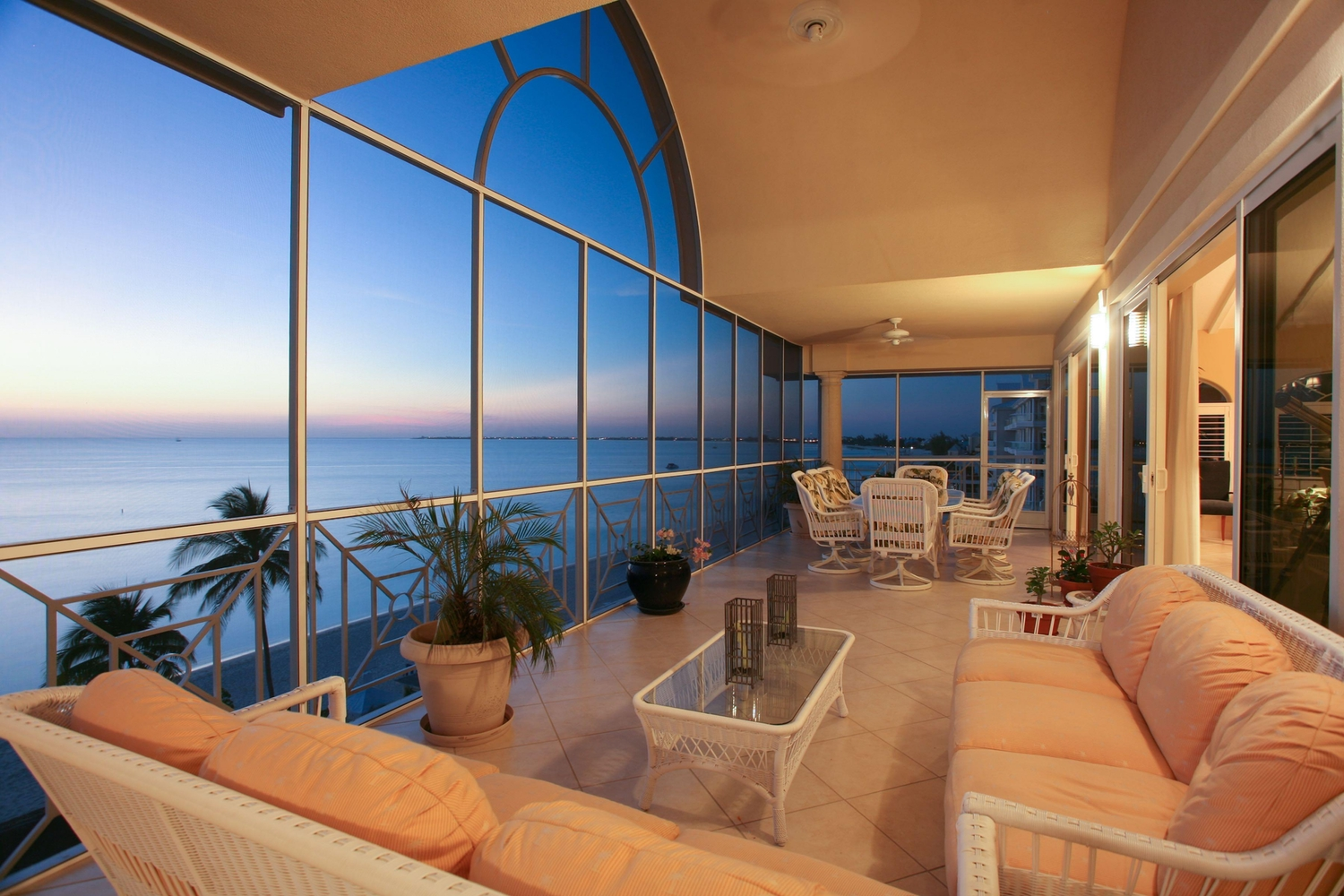 Enclosed patio overlooking the ocean at sunset