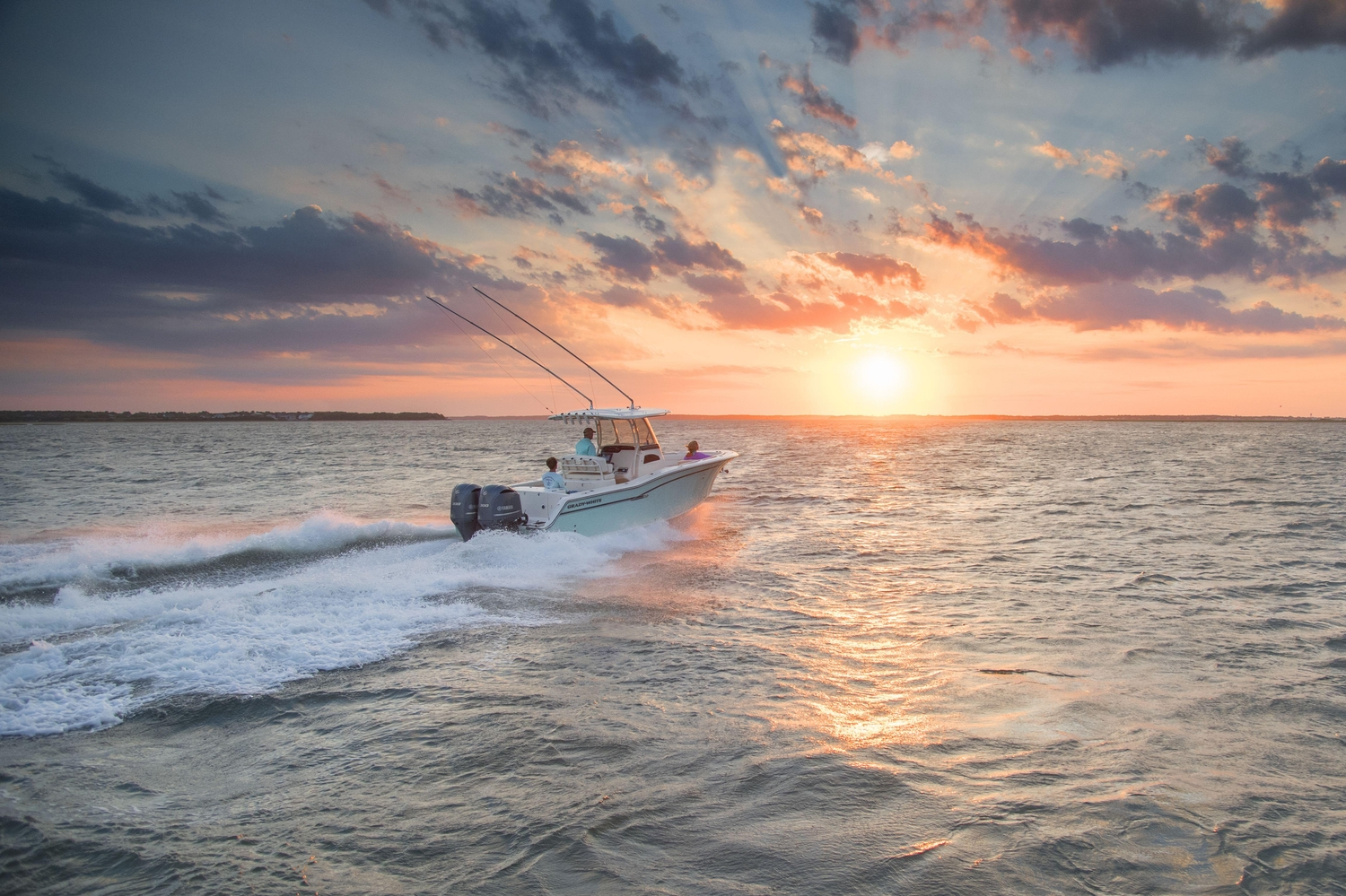 Fishing boat cruising out to sea during sunrise
