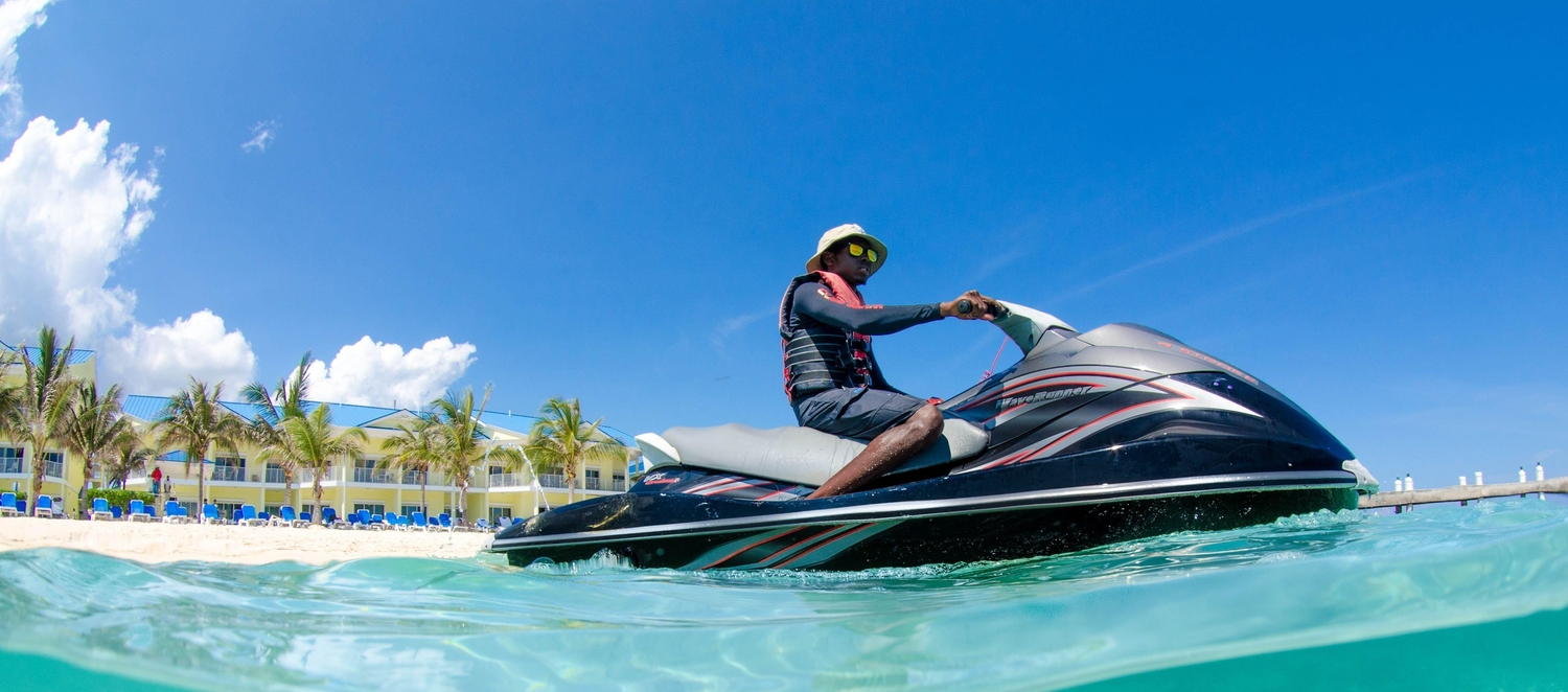 Guy with hat and sunglasses on a jetski in Cayman