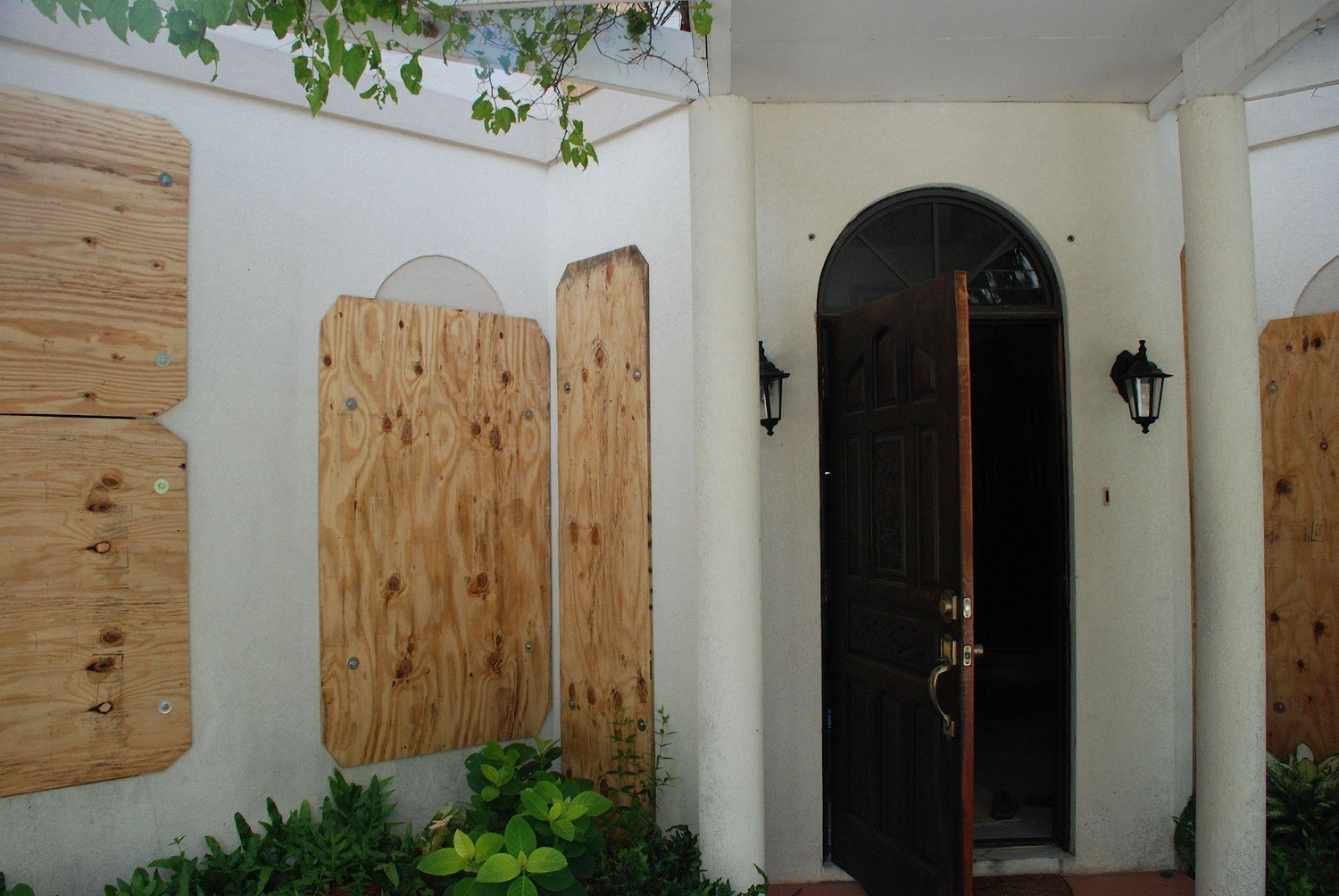 House protected with hurricane shutters