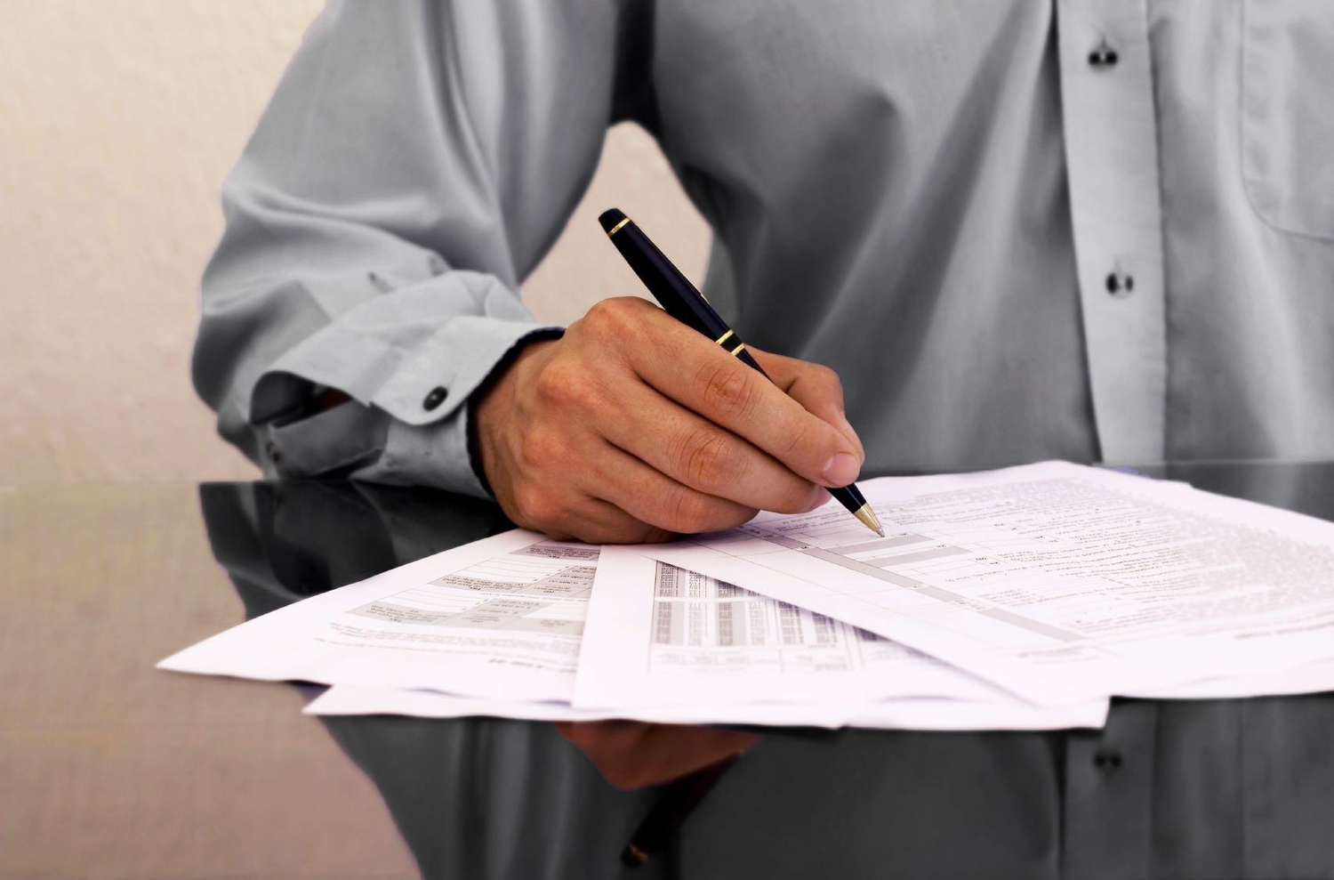 Man auditing financial statements