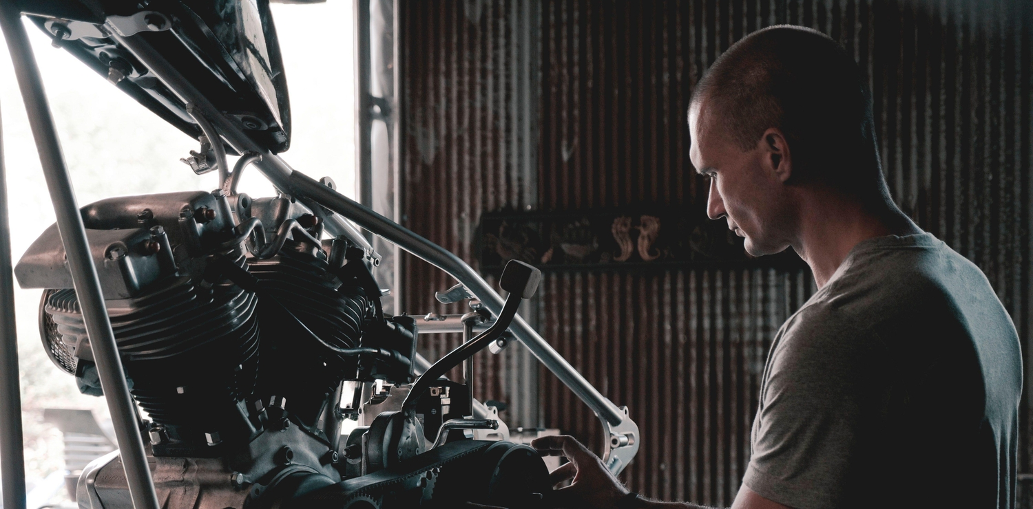 Mechanic working on a car engine in a garage