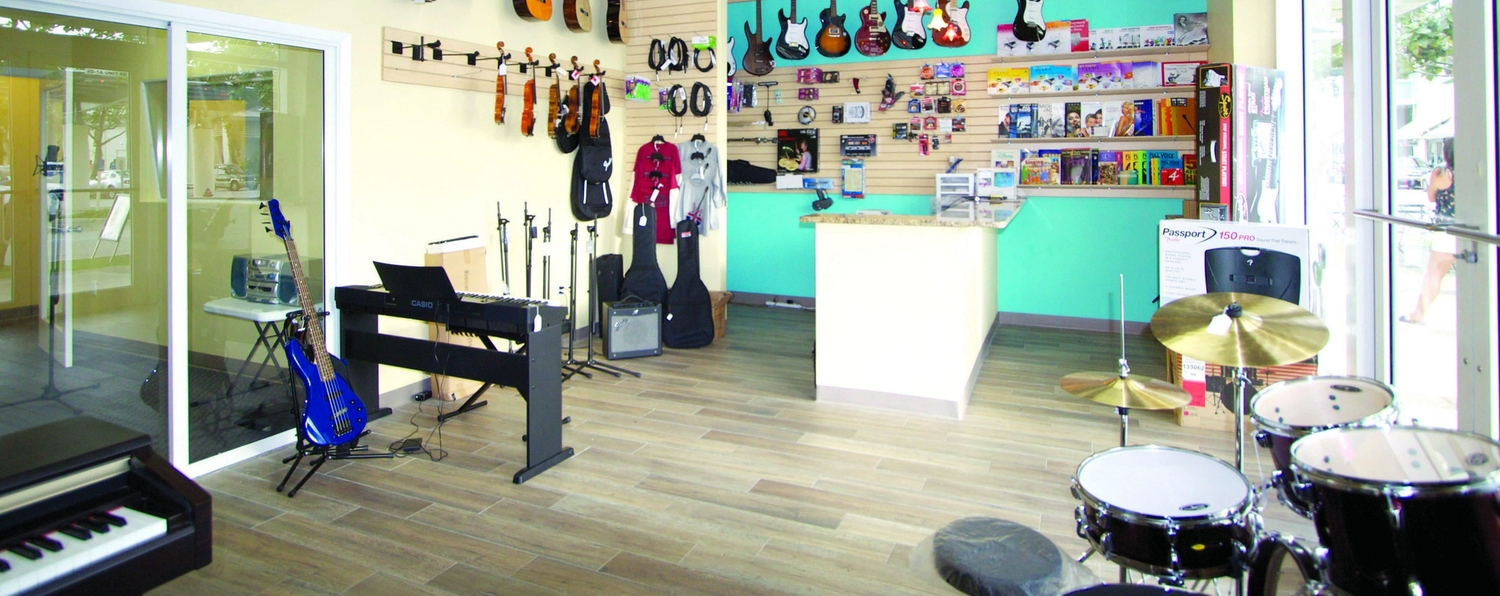 Music shop with several guitars hanging in the walls