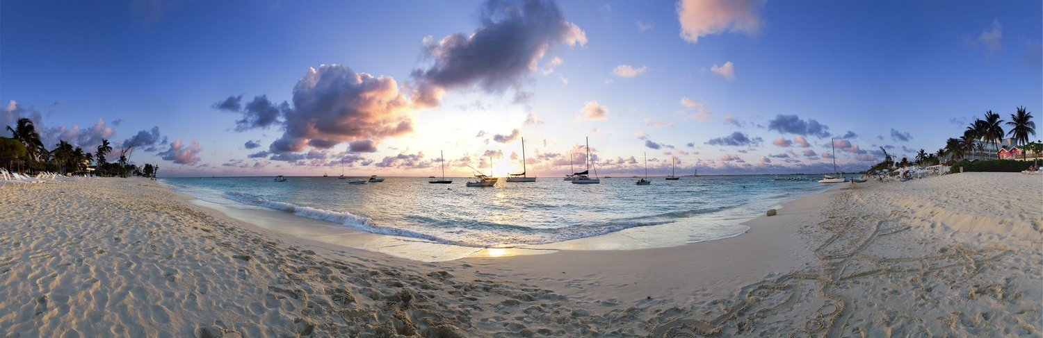 Panoramic shot of boats anchored offshore in the Cayman Islands