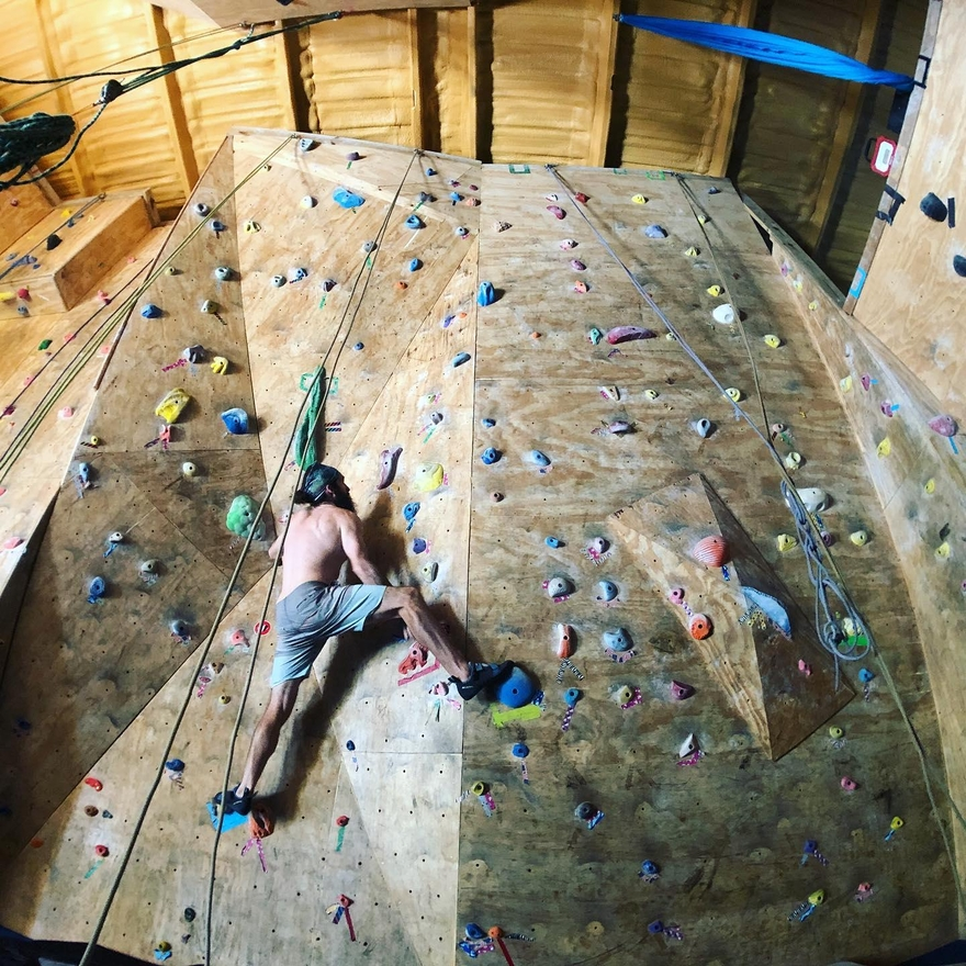 Person indoor rock climbing