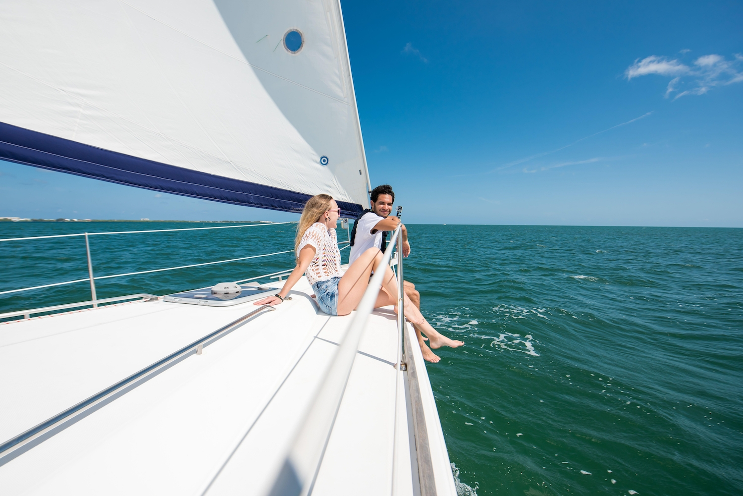 Couple out on a sailing boat in the Cayman Islands