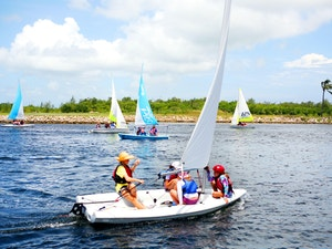 Several sailing boats in the waters of the Cayman Islands