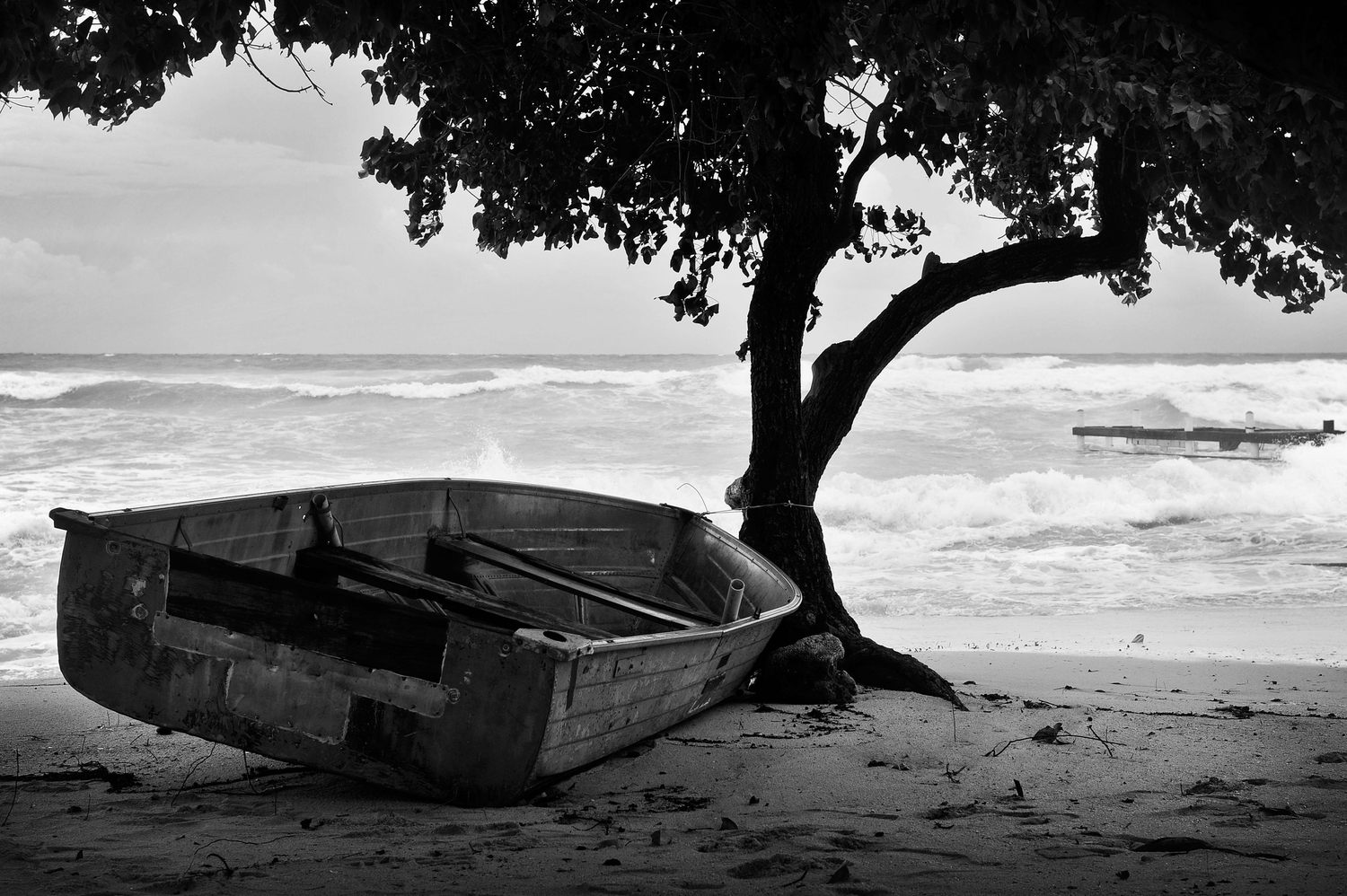 Small boat on the beach in a storm