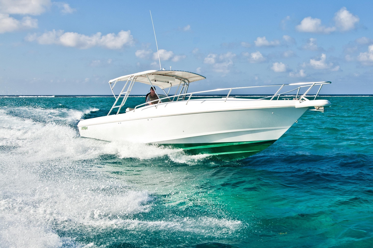 Speed boat cruising in the Cayman Islands
