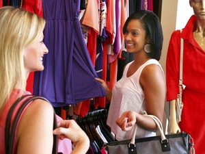 Two Ladies Shopping For Dresses