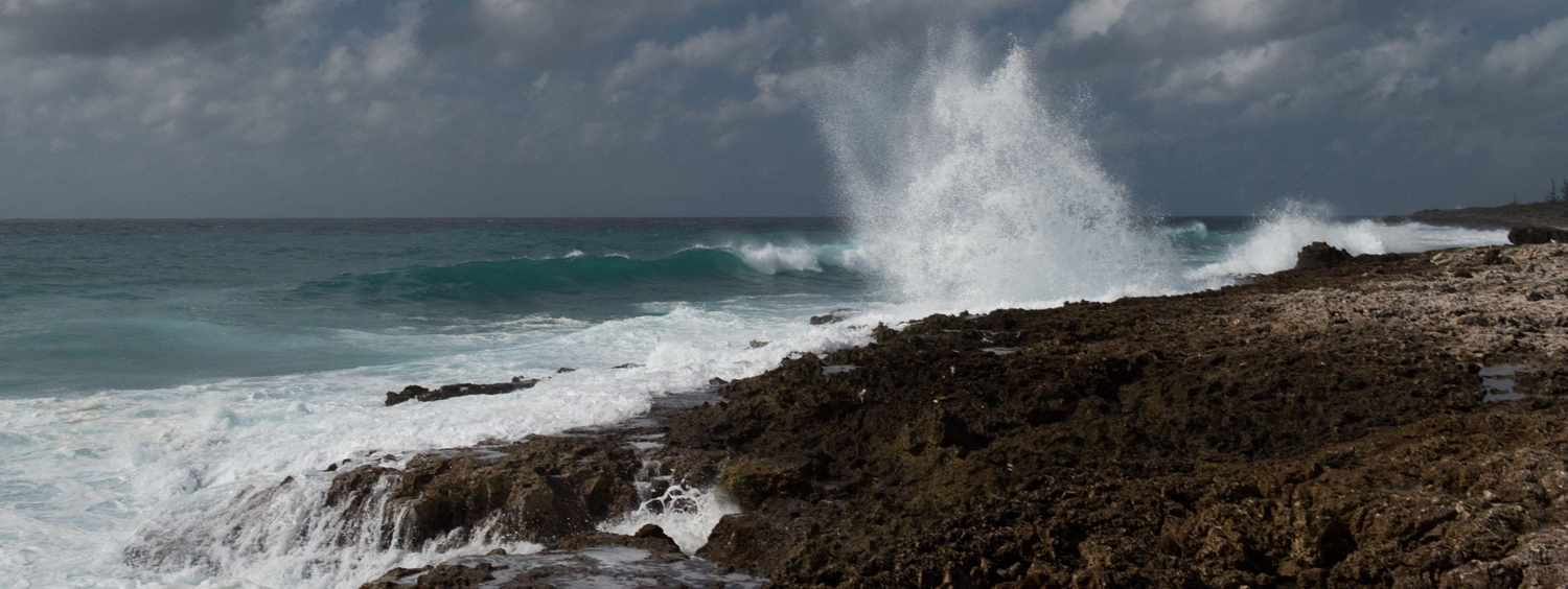 Waves crashing against rocks in the Cayman Islands