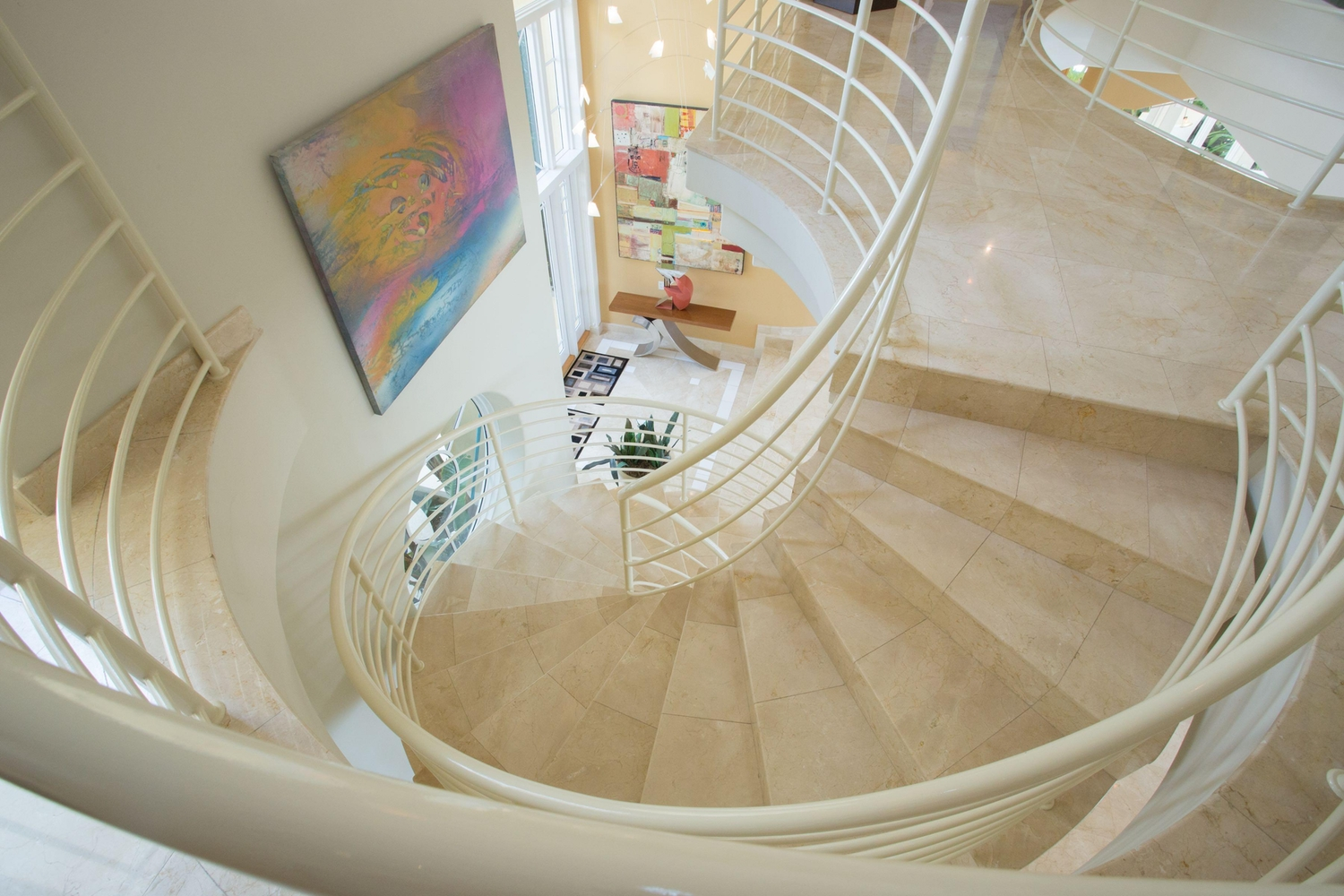 Aerial view of a spiral staircaise with a tiled floor
