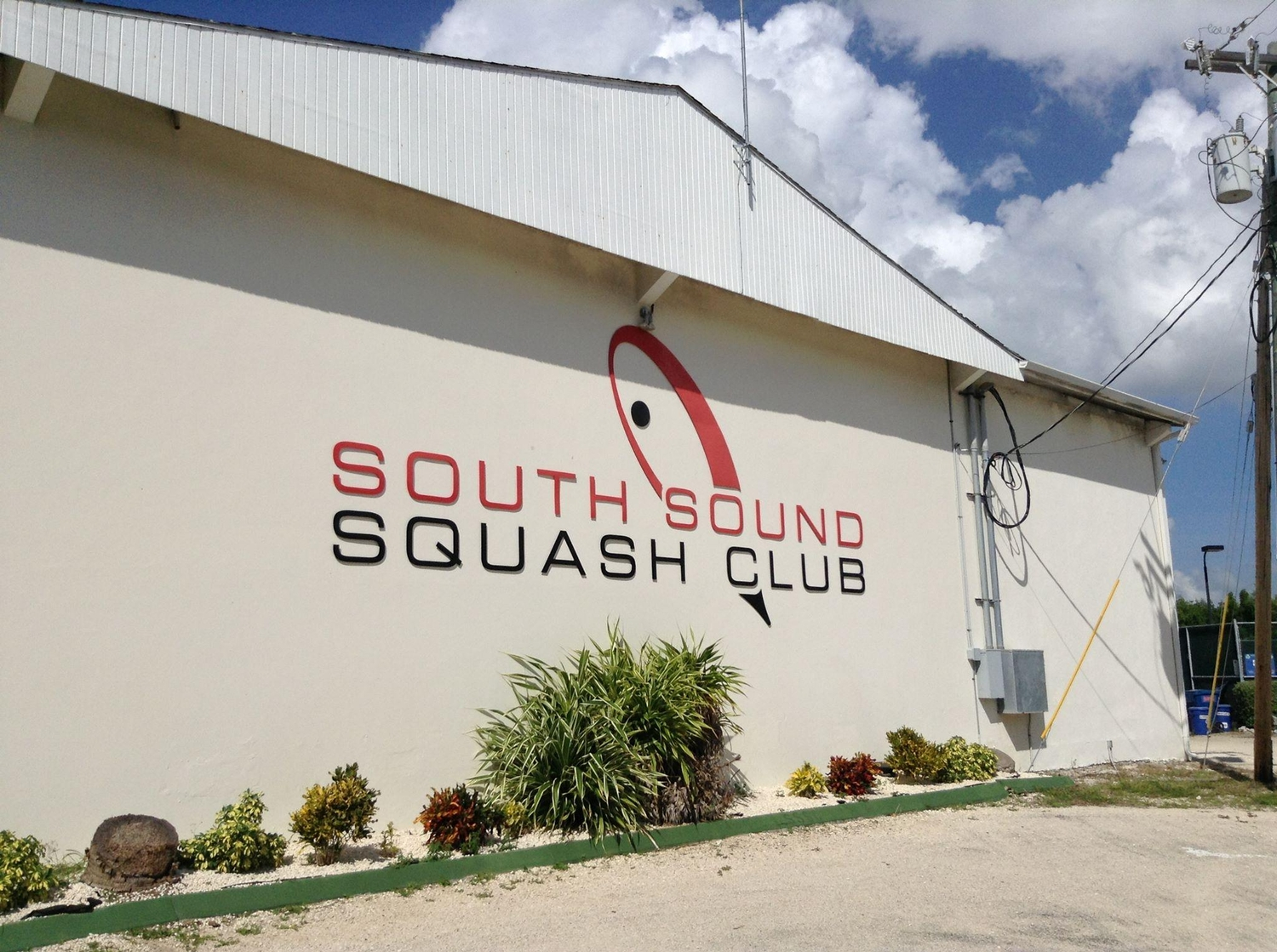 Beige exterior of the south sound squash club building
