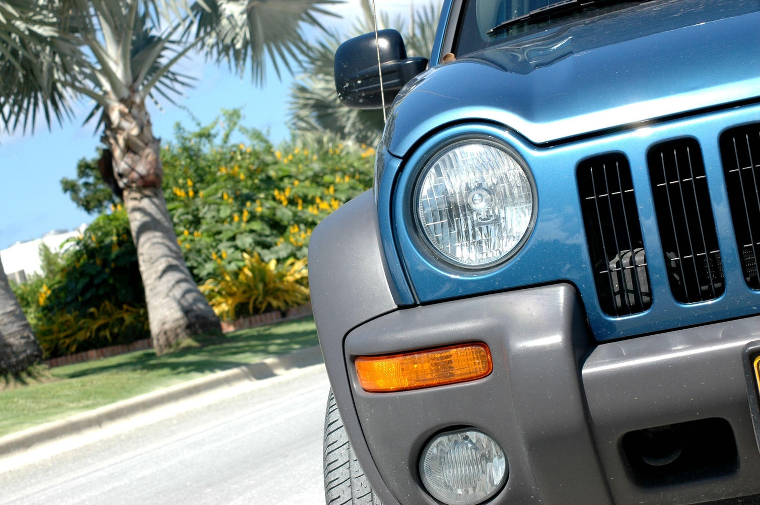 Blue jeep liberty driving