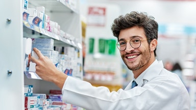 Brunette man working behind the counter at the pharmacy