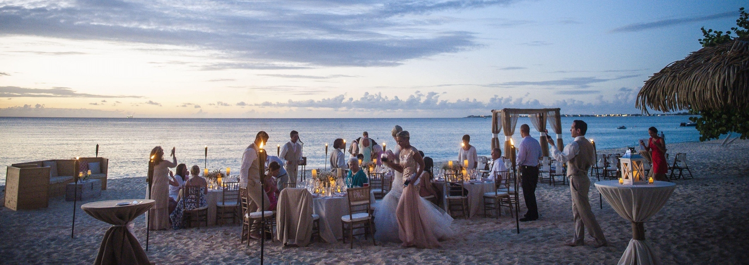 Candlelit sunset wedding on the beach