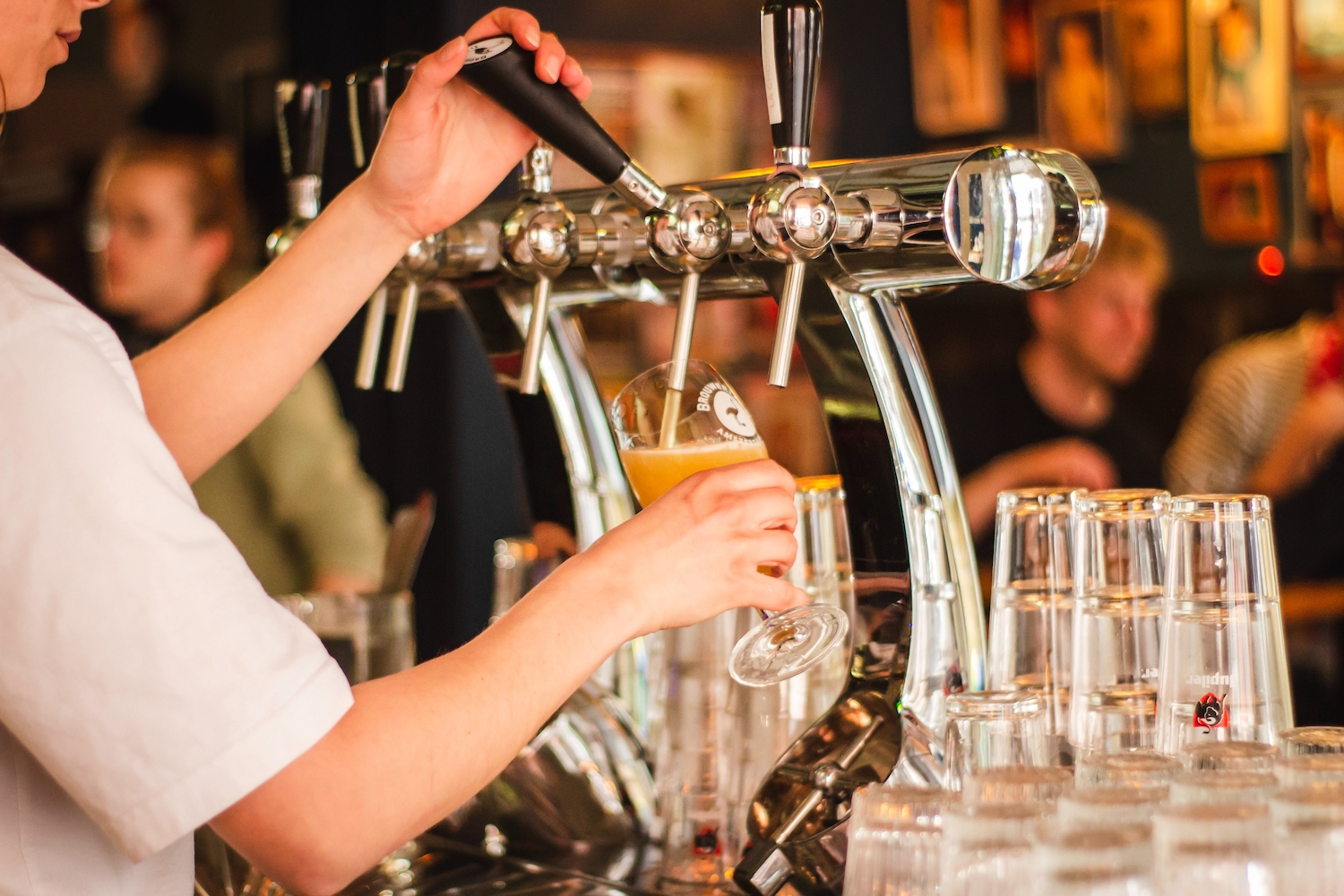 Close crop of bartender pouring a draught beer