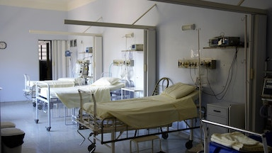 Empty hospital beds in a room