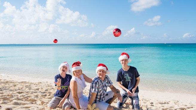 Family enjoying christmas on the beach in cayman