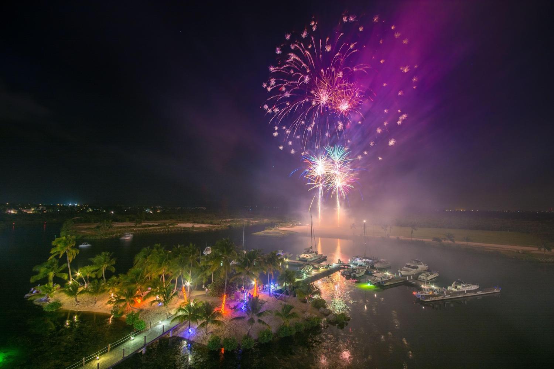 Fireworks at night over camana bay