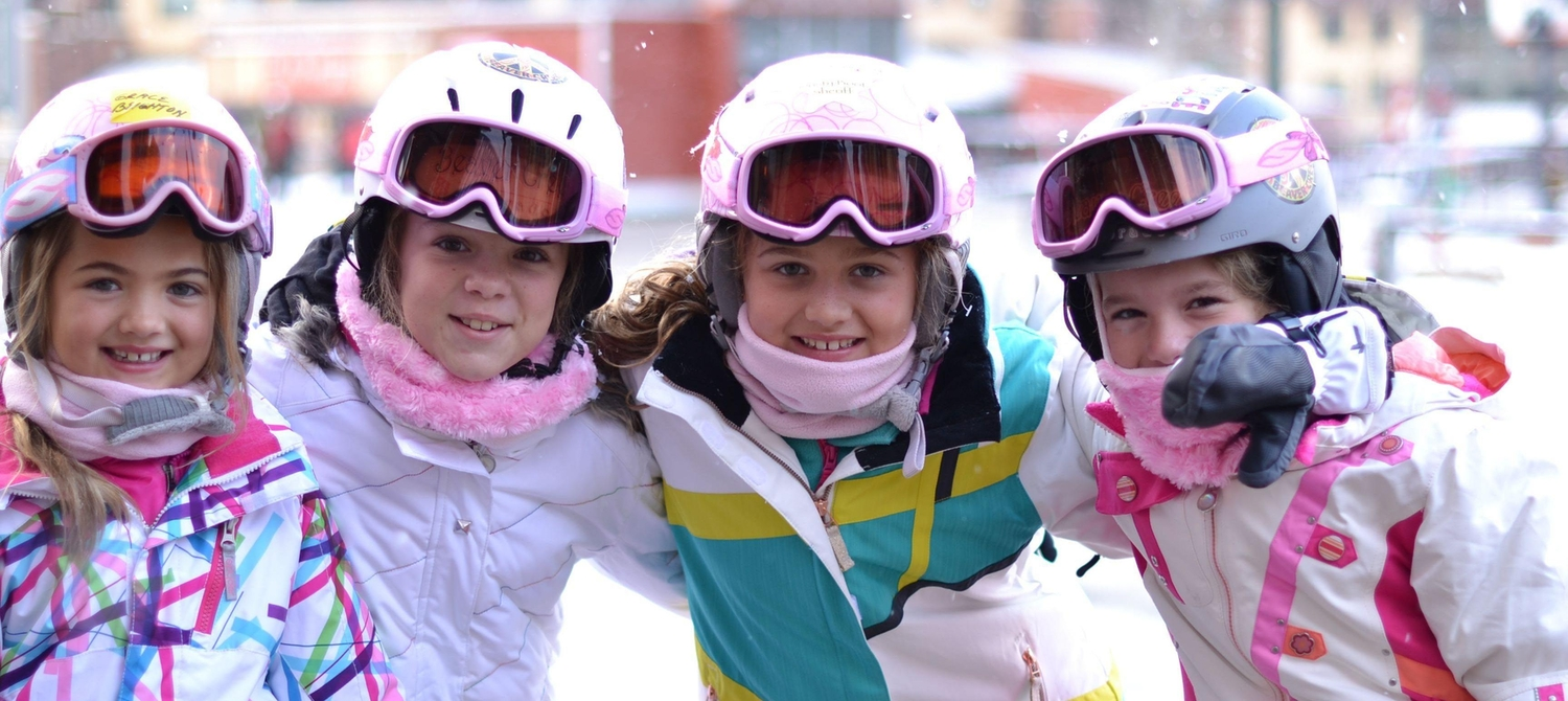 Four little girls enjoying a ski holiday