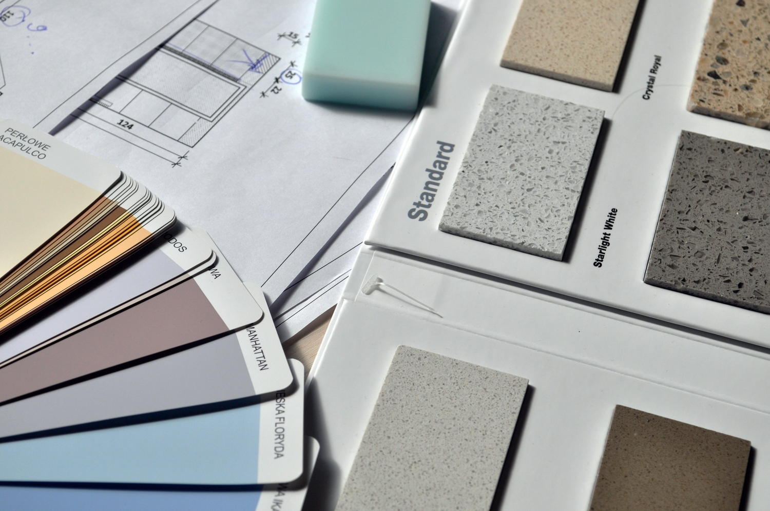 Gray paint swatch book near tile samples