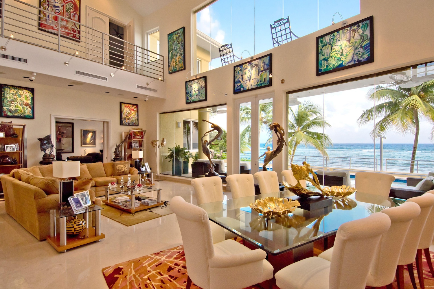 Interior of a den overlooking the ocean with lots of paintings