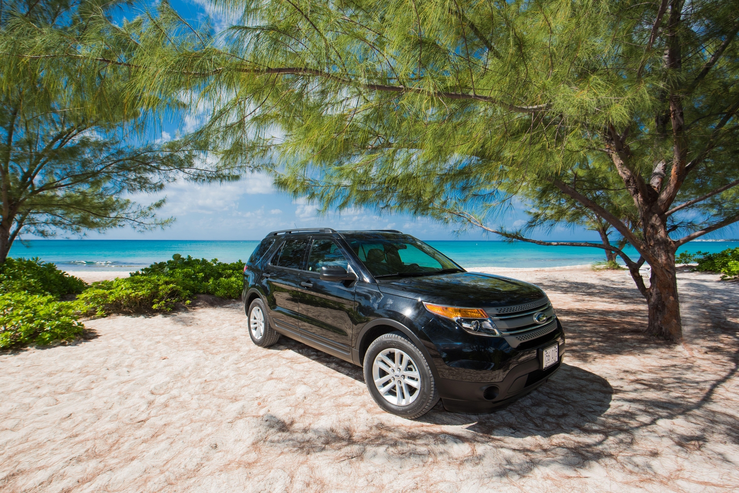 Large black ford SUV parked on angle at barkers beach