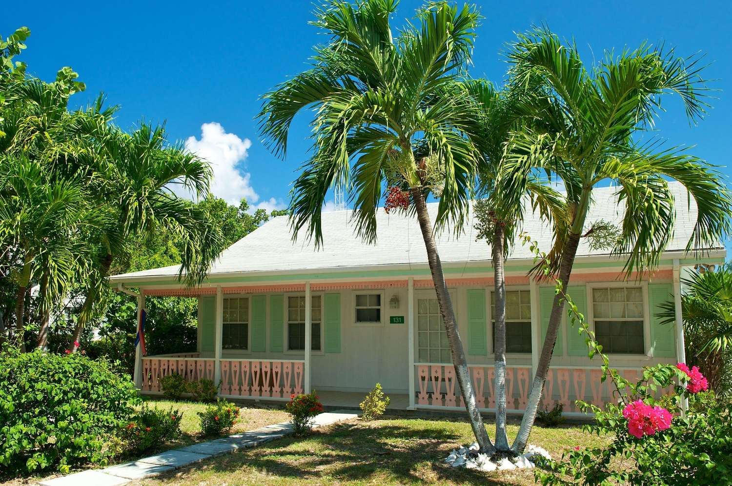 Old cayman style home in light green