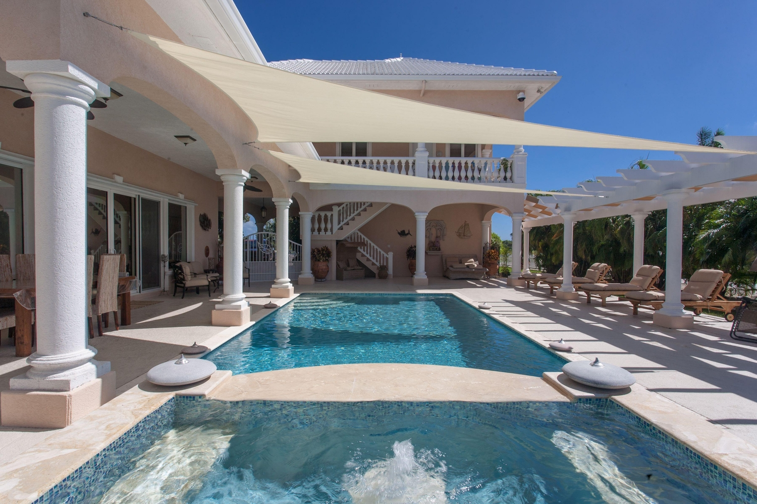 Outdoor patio over looking luxury hottub and pool