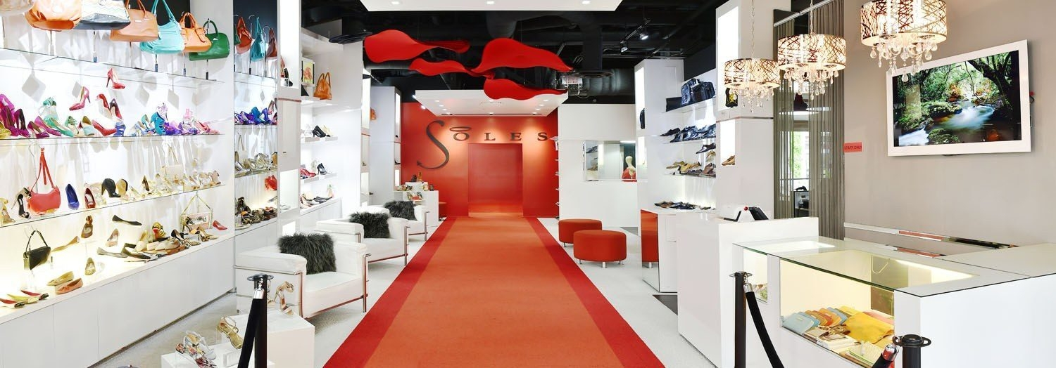 Panorama of soles shoe store with red carpet