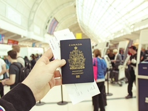 Person holding a canadian passport in airport