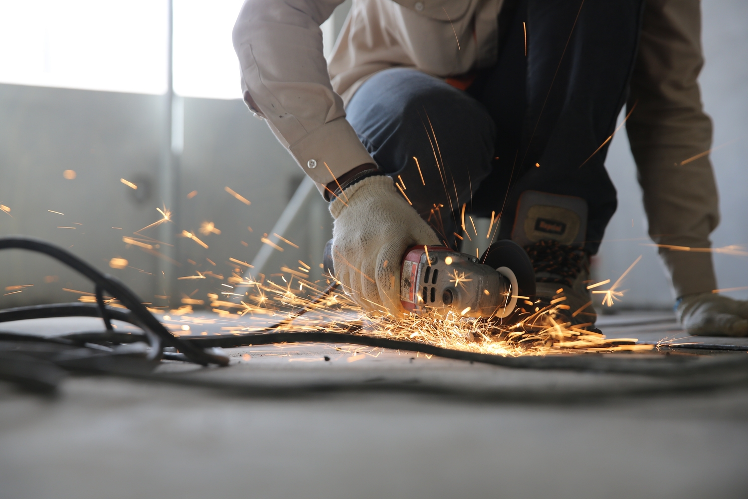Person holding grinder with sparks