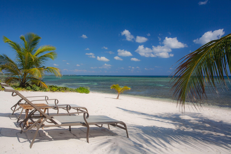 Sun lounger chairs on deserted beach