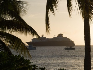 Sunset silhouette of cruise ships in george town